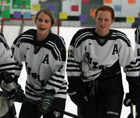 Kingston, MA 02/18/12 Duxbury HS takes on St Mary's in girls hockey , pitting two of top squads in EMass. Junior forwards Lily Connolly,left, and Hannah Murphy,right, after pre game ceremonies on senior night. ( George Rizer for the Boston Globe)